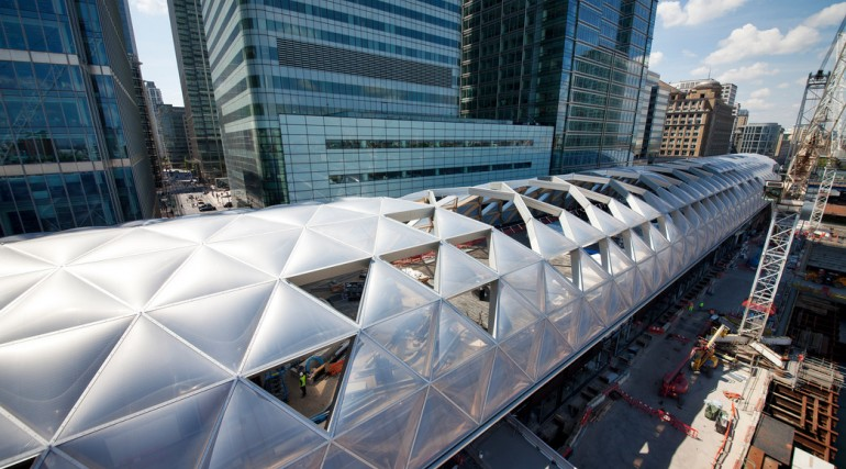 Construction of striking lattice timber roof above Canary Wharf Crossrail station_144156