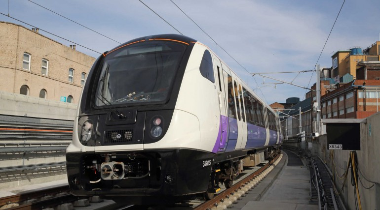 Elizabeth line test train passes through Custom House station - April 2018_303104