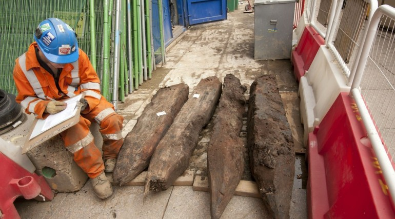 Elm timber piles from 16th century wall foundation at Bethlem Ground being recorded_132798