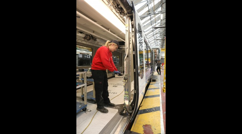 Engineer working on new Elizabeth line train manufacture at Bombardier Transportation UK