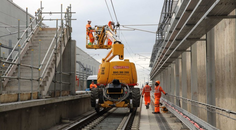 Engineers install overhead wiring at North Woolwich portal_279986