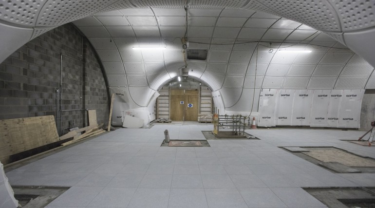 Farringdon station - curved glass-fibre reinforced concrete panels line the platform tunnels - June