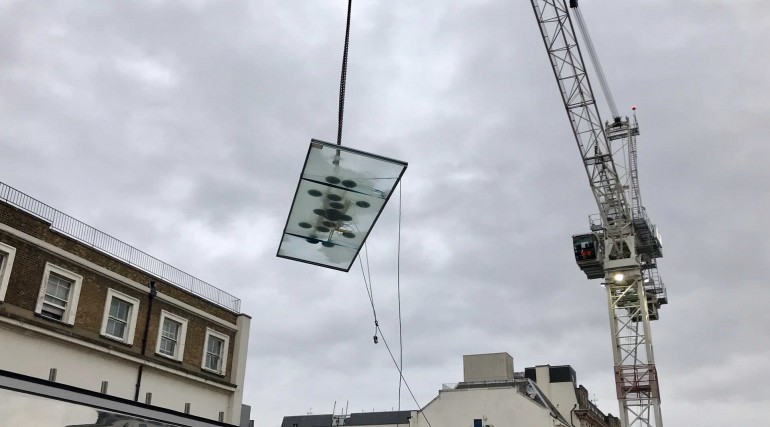 First panels of Spencer Finch_s artwork lifted into place in Paddington station canopy_293256